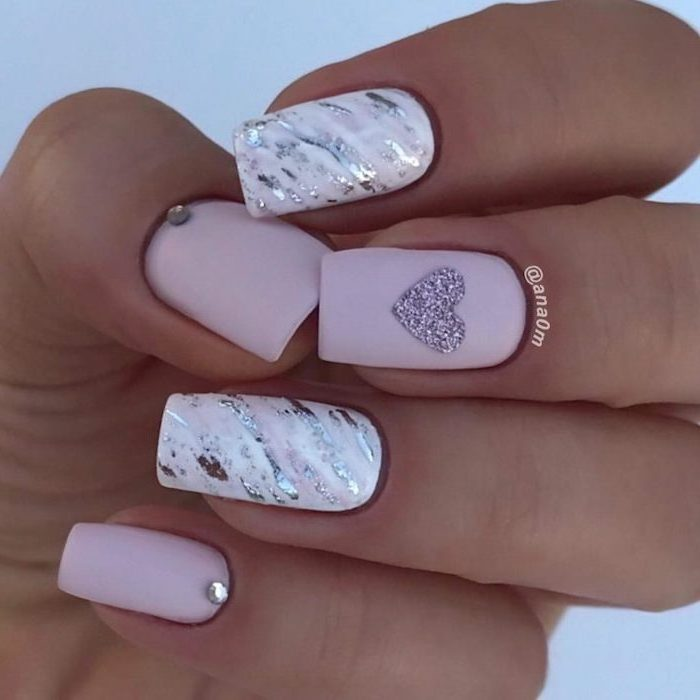 pink and white nail polish, decorations with silver glitter, french tip nail designs, decorations with rhinestones