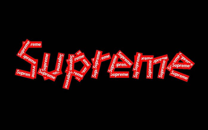 logo written with other small logos in red and white supreme background on black background