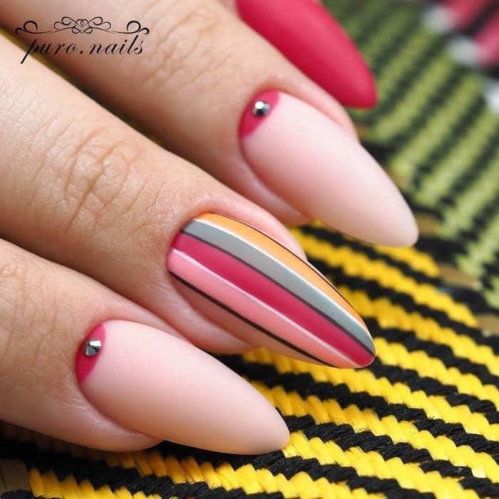 light pink nail polish, french tip nail designs, colorful lines decorations, matte nail polish