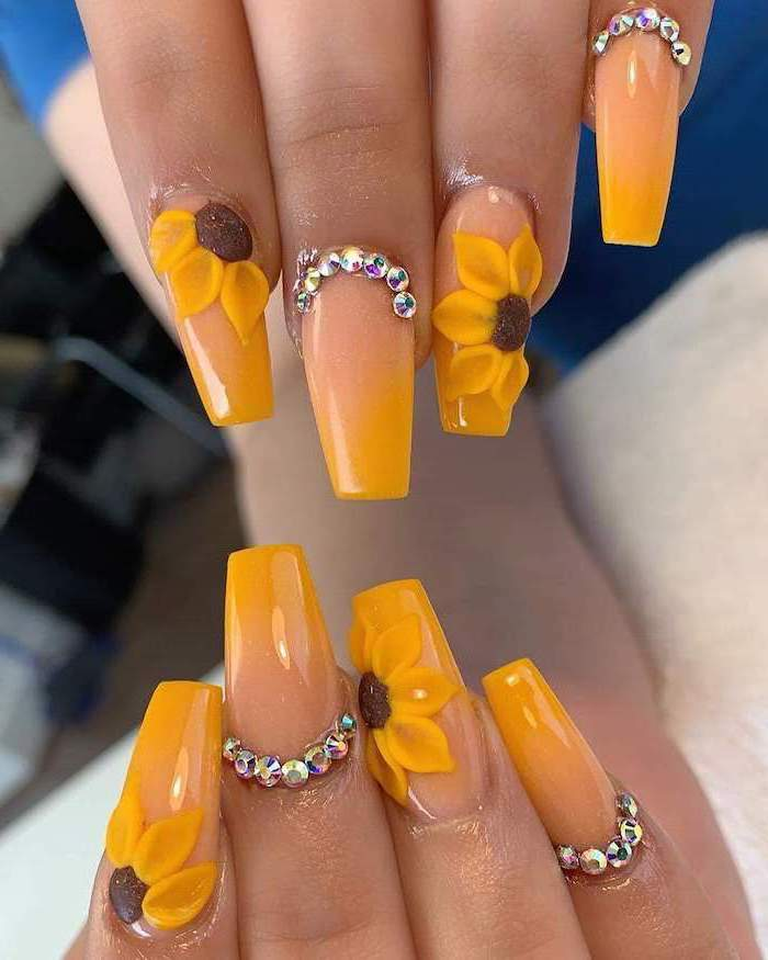 sunflowers decorations, nude and yellow nail polish, ombre nails, french tip nail designs, decorations with rhinestones