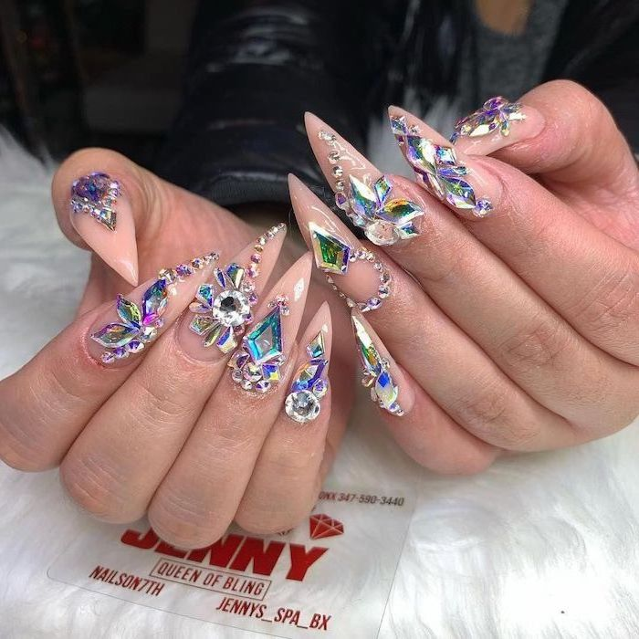 long stiletto nails, bright nail colors, nude nail polish, decorations with different rhinestones