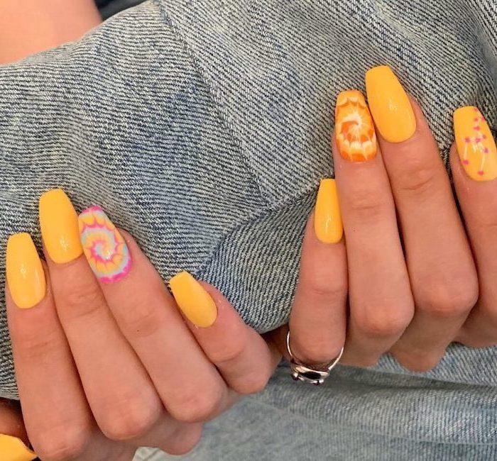 yellow nail polish, medium length coffin nails, bright nail colors, tie dye decorations
