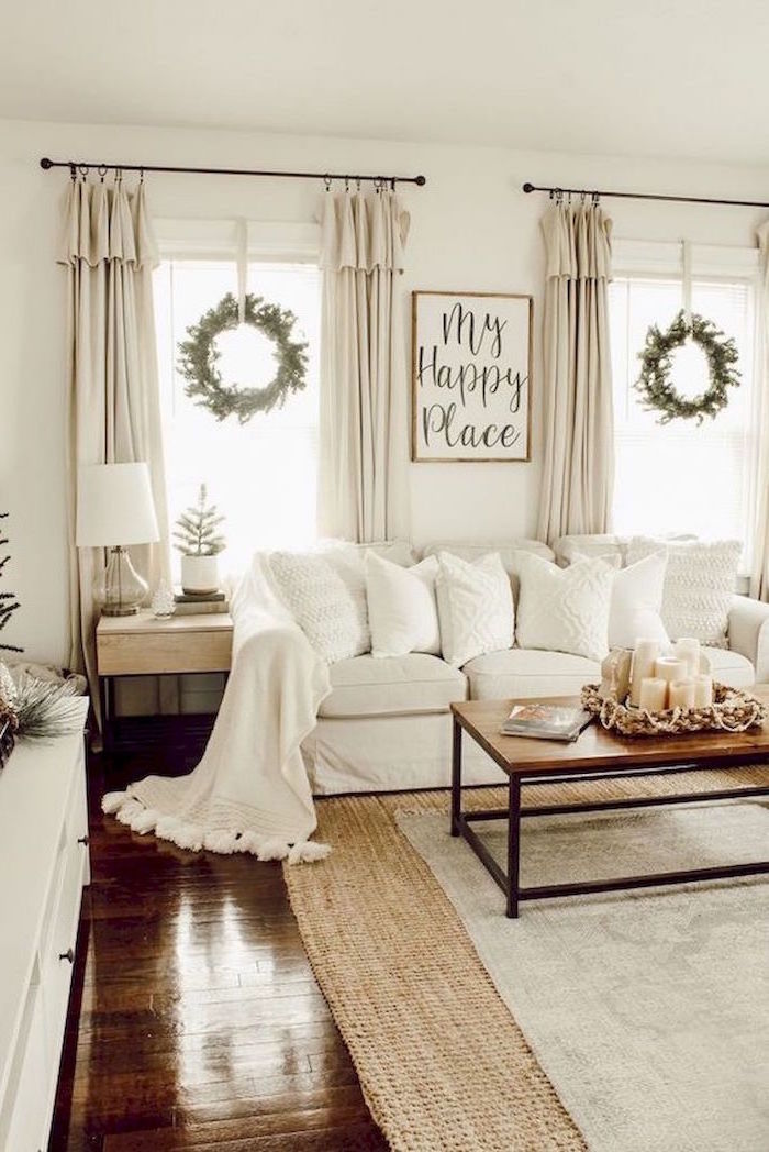 white walls, white sofa, wooden coffee table, country decorating ideas, white carpet on dark wooden floor