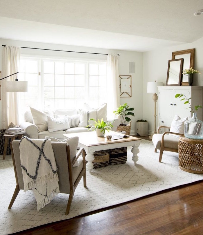 white sofa, two grey armchairs, country decorating ideas, wooden coffee table, white carpet on wooden floor