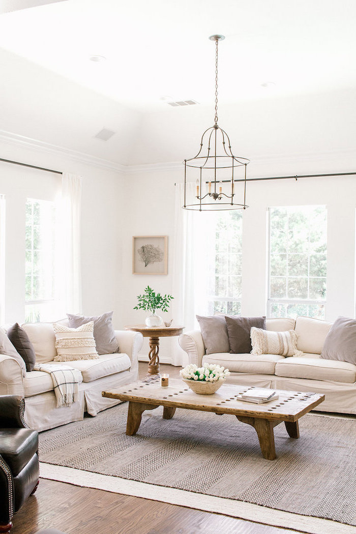 two white sofas, white and grey throw pillows, wooden coffee table, country decorating ideas