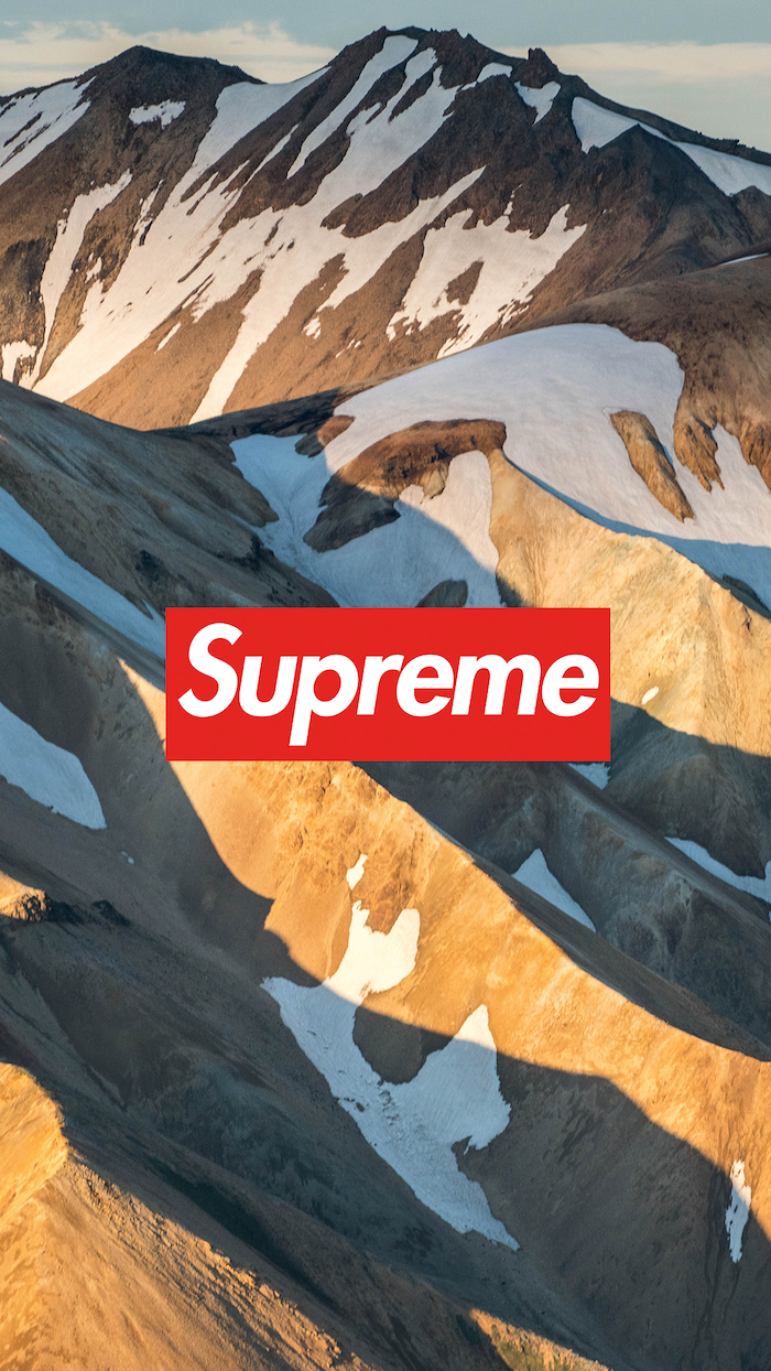 mountain landscape with snowy peaks supreme wallpaper for iphone red and white supreme logo in the middle