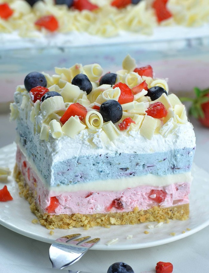 no bake dessert recipes dessert lasagna made with blueberries and strawberries layered and topped with white chocolate strawberries and blueberries