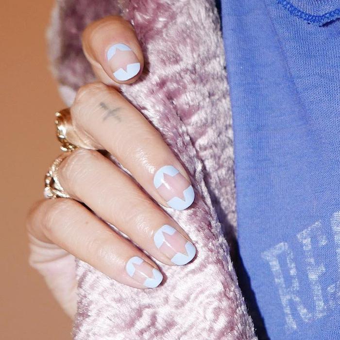 nail ideas 2020, short squoval nails, nude and blue nail polish, abstract shapes decorations