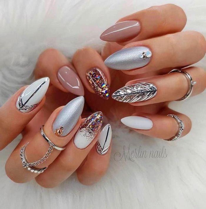 nude and white nail polish, silver glitter nail polish, acrylic nail colors, decorations with rhinestones, long almond nails