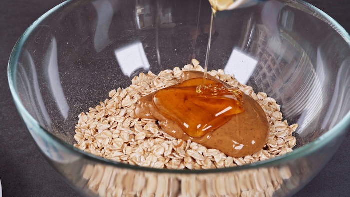 oats peanut butter and honey poured into glass bowl dessert ideas for party placed on grey surface