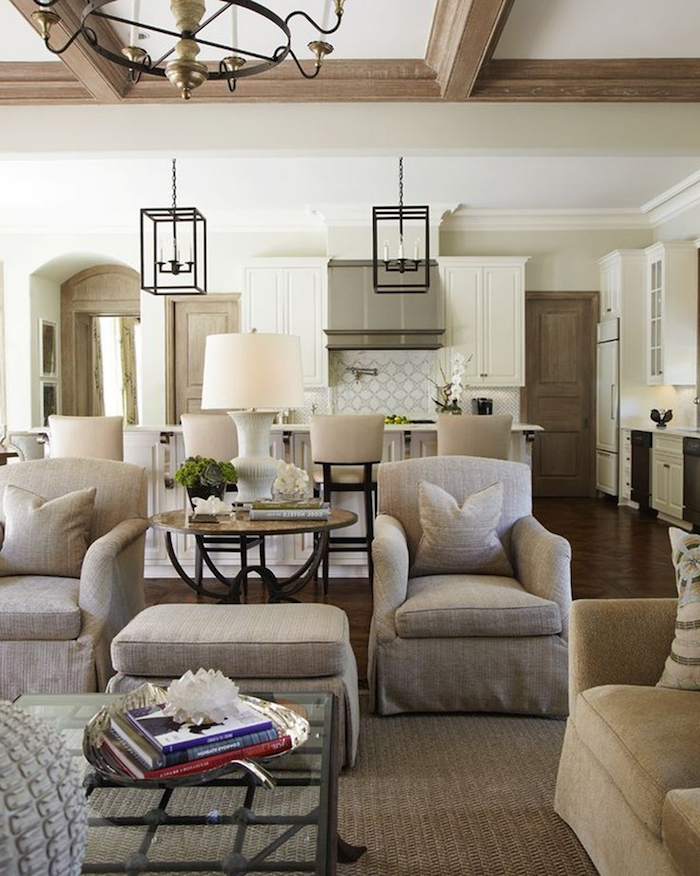 two grey armchairs and ottoman, country decorating ideas, open plan living room and kitchen