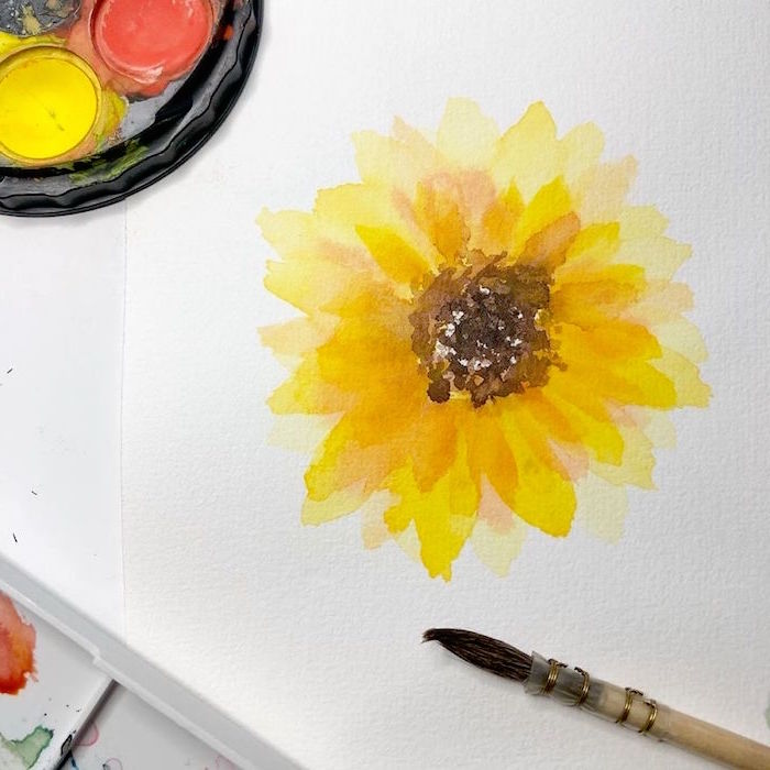 orange yellow watercolor sunflower, how to use watercolor paint, painted on white background, paintbrush on the side