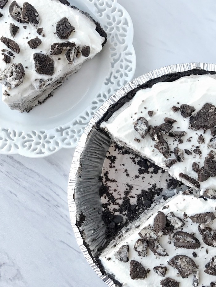 oreo pudding pie with three layers best summer desserts placed on white wooden surface