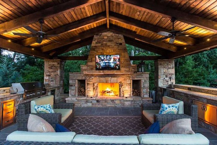 outdoor grill ideas vaulted wooden ceiling with fans stone fireplace lounge are with sofas and armchairs grill with cabinets