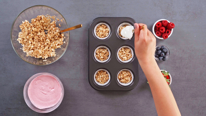 paper lined muffint tray dessert ideas for party oats mixture on the bottom skyr mixture on top