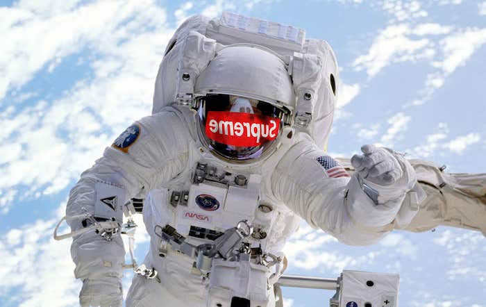 photo of a nasa astronaut in space supreme louis vuitton wallpaper supreme logo mirrored on his helmet