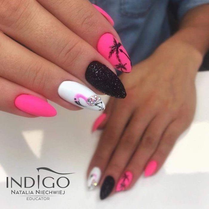 pink and white nail polish, black glitter nail polish, flamingos and palm trees decorations, pretty nail designs