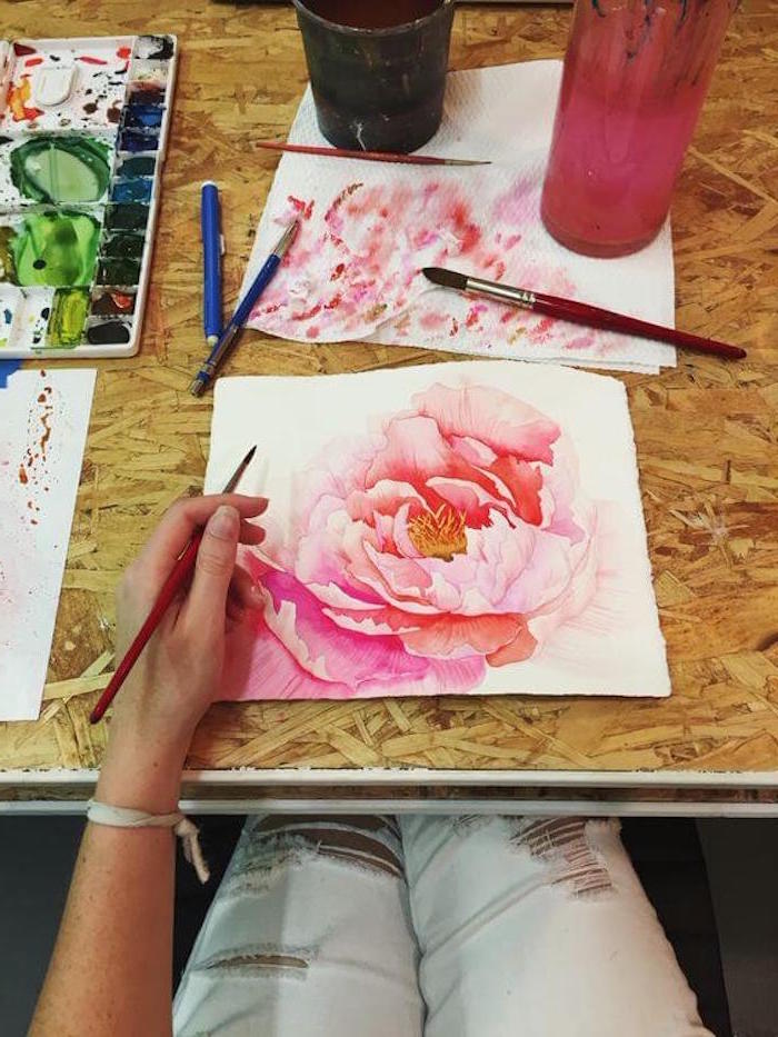 pink peony flower, painted on white background, how to paint with watercolors, painting placed on wooden surface