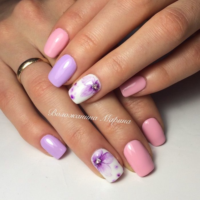 pink and purple nail polish, blue nail designs, purple flowers decoration, medium length squoval nails