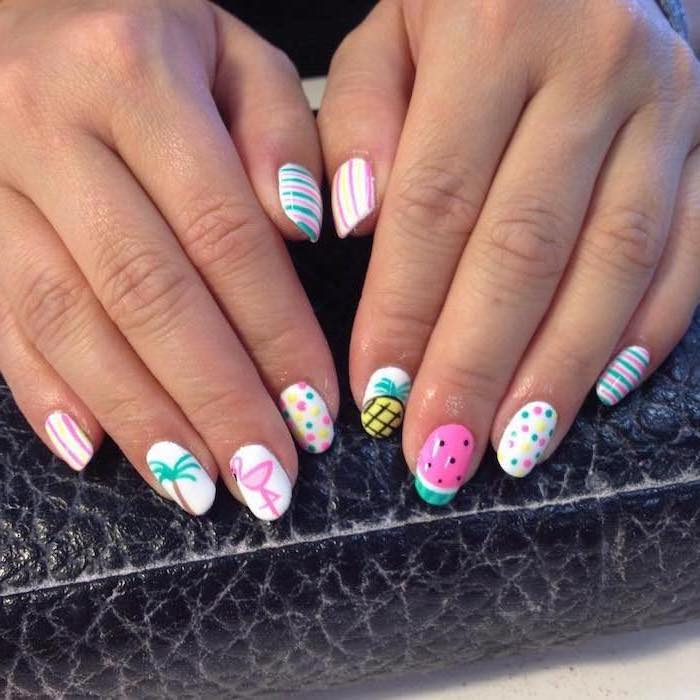 white nail polish, different colorful decorations, cute acrylic nail ideas, medium length squoval nails