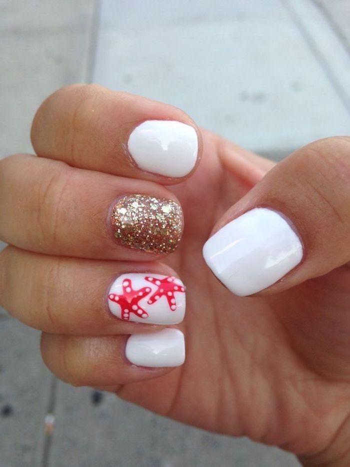 cute acrylic nail ideas, white nail polish, gold glitter nail polish, sea stars decorations