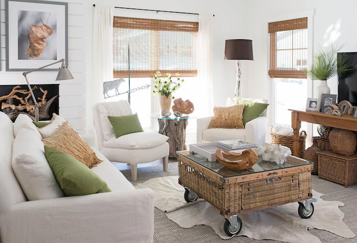 ratan coffee table on wheels, white furniture set, green throw pillows, modern farmhouse interior, white walls