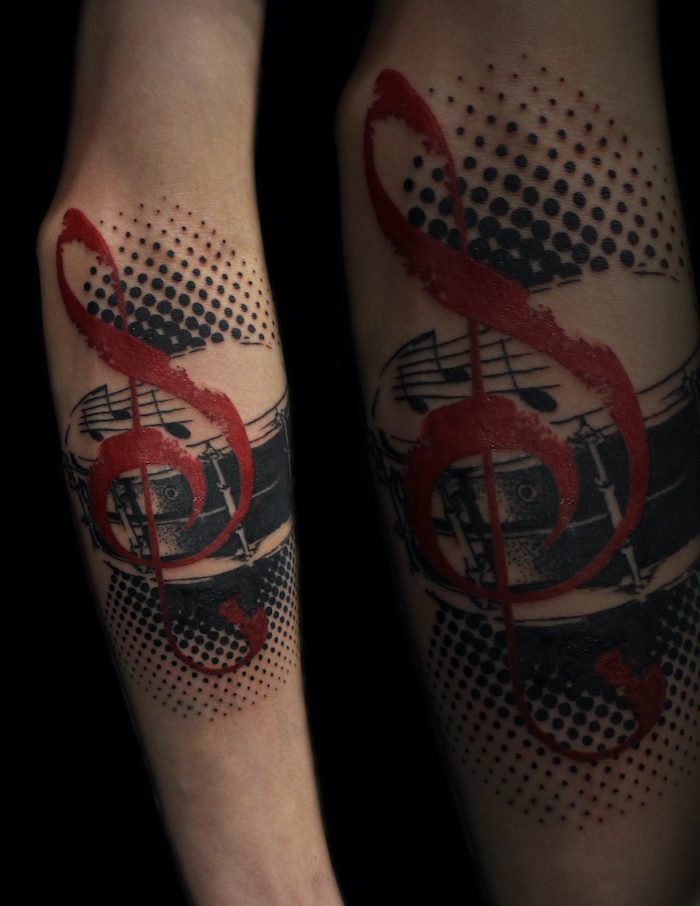 red musical key note white trash tattoo ideas drum surrounded by black dots forearm tattoo