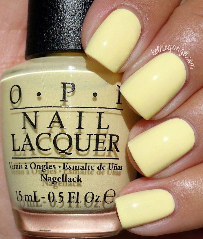 yellow nail polish, vacation nails, short square nails, bottle of yellow nail polish