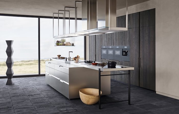 modern kitchen, silver kitchen island, dark wooden cabinet, black tiled floor, tall windows, hanging lamps