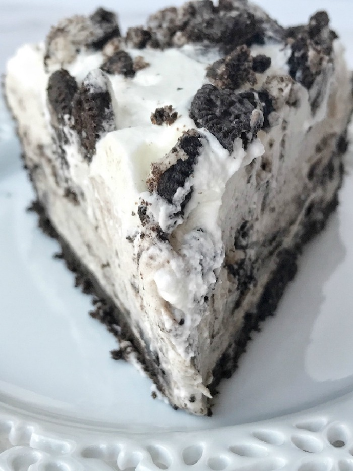slice of oreo pudding pie with three layers on white plate best summer desserts made with oreo cookie crumbs