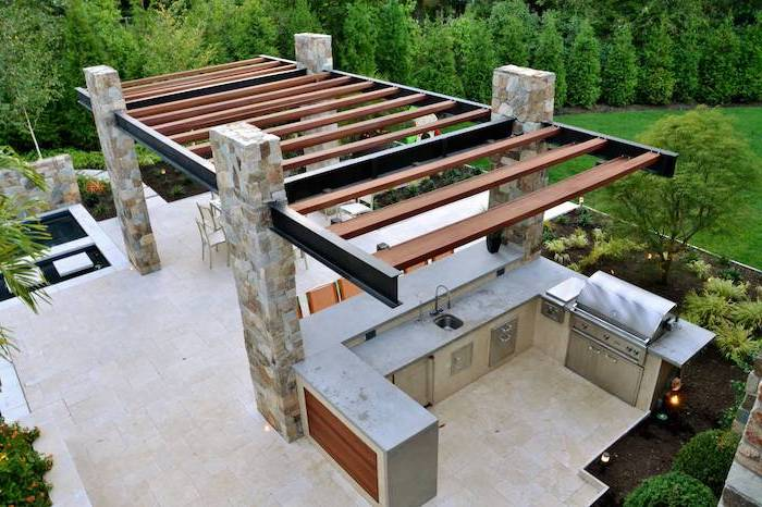 stone tiled floor and columns l shaped outdoor kitchen kitchen area with grill sink metal cabinets