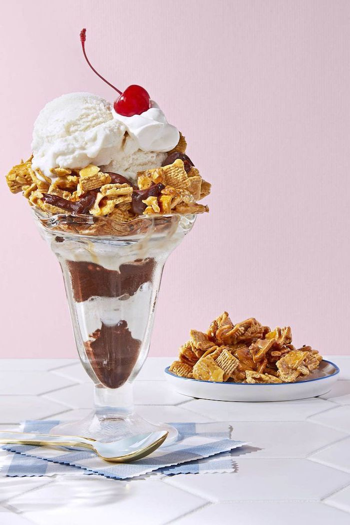 summer dessert recipes chocolate parfait inside a tall glass decorated with ice cream cherry on top