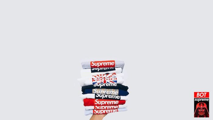 supreme background a bunch of folded t shirts in black and white stacked together on white background