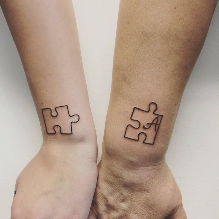 two jig saw puzzles letter a inside one brother sister tattoos small wrist tattoos white background