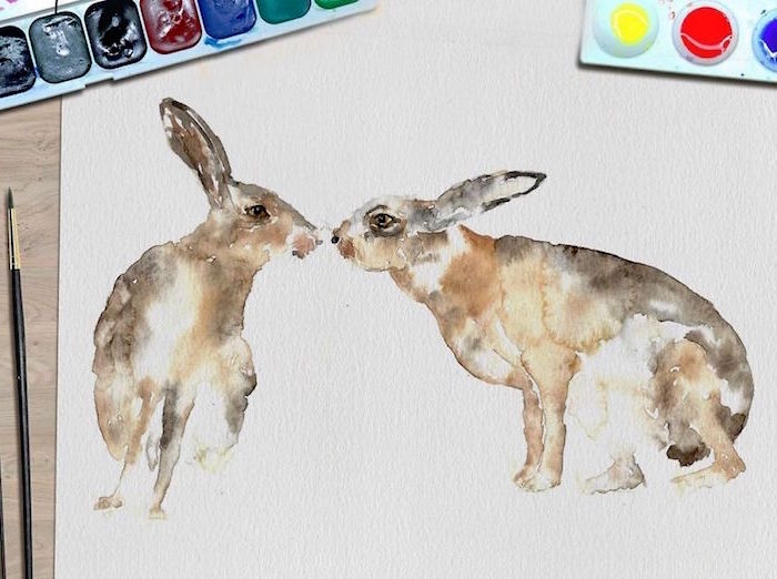 painting of two rabbits, things to paint with watercolor, painted on white background, placed on wooden surface