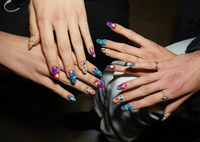 two sets of hands, colorful nail polish, summer nail colors, colorful decorations, long squoval nails
