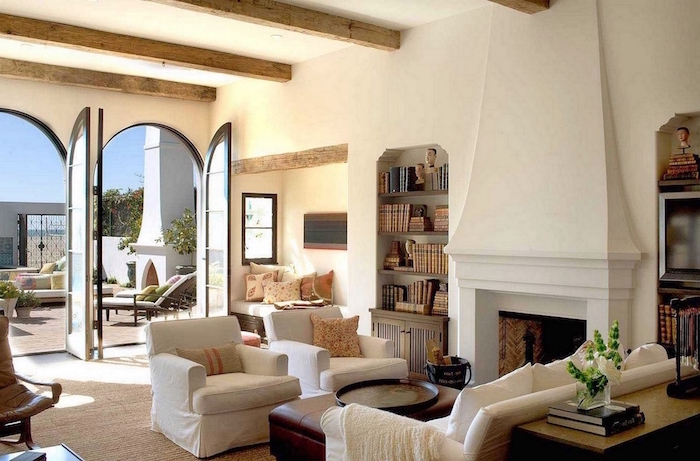 exposed wooden beams on white ceiling, modern farmhouse interior, white furniture set, brown leather ottoman