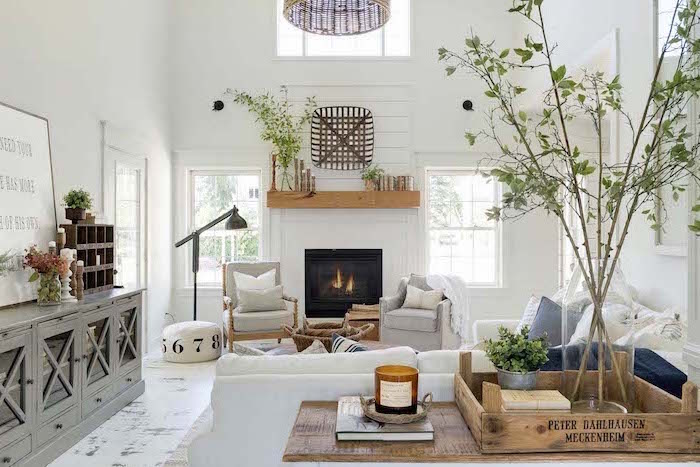white furniture set, placed in front of a fireplace, farmhouse living room furniture, tall white walls