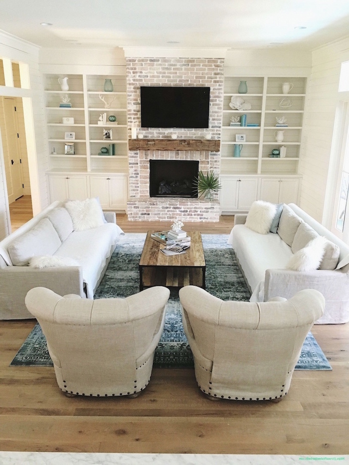 white furniture set, placed in front of a fireplace, farmhouse living room furniture, brick accent column