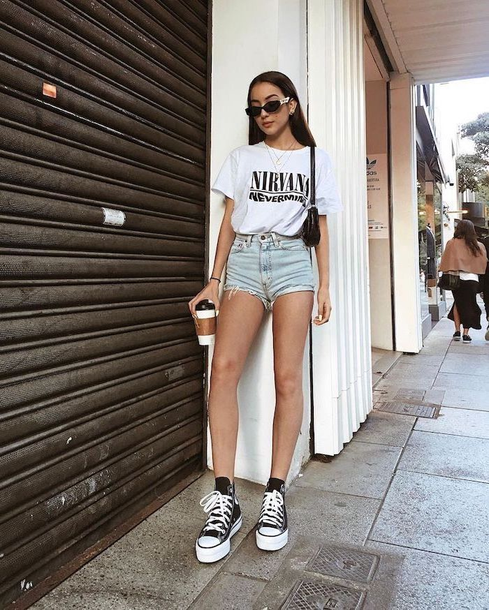 white nirvana t shirt denim shorts worn by girl with long black hair cute summer outfits for teens black and white converse high tops sunglasses