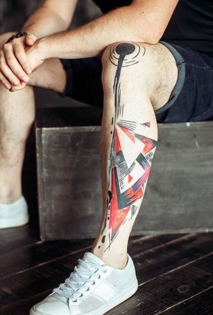 white sneakers short jeans trash polka style leg tattoo on man abstract triangles geometrical shapes