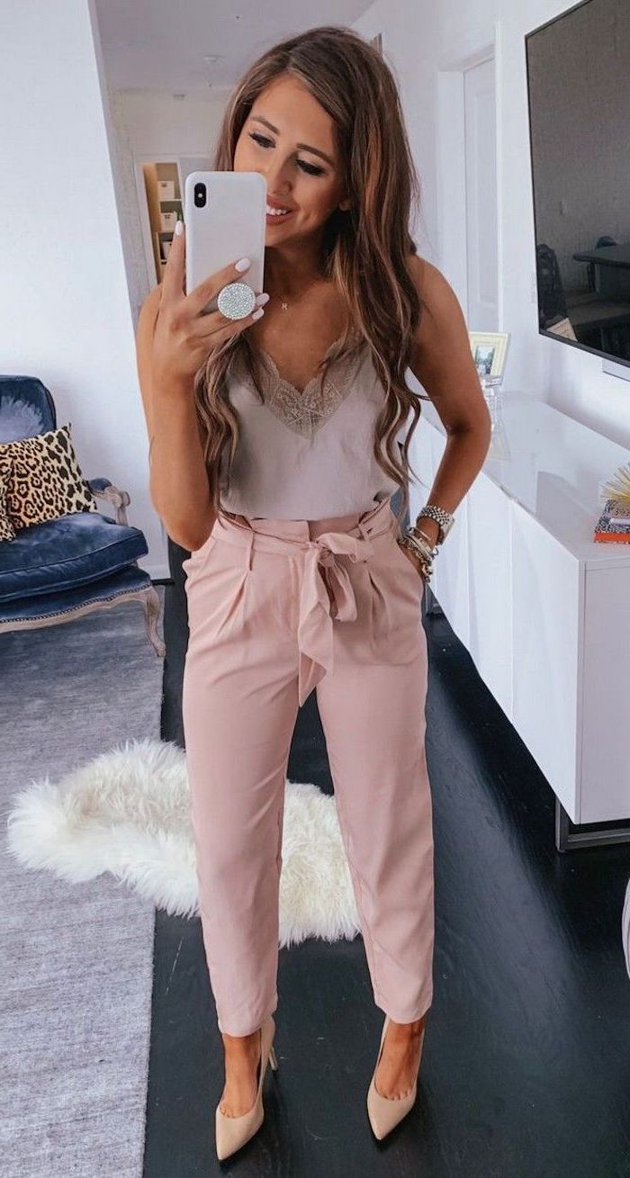 woman wearing white lace top pink trousers with high waist summer outfit ideas beige heels