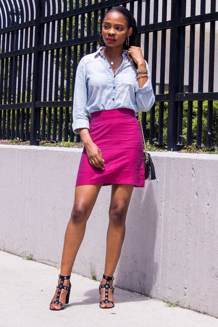 woman with black hair in ponytail cute summer shirts wearing pink skirt denim shirt black sandals small crossbody bag