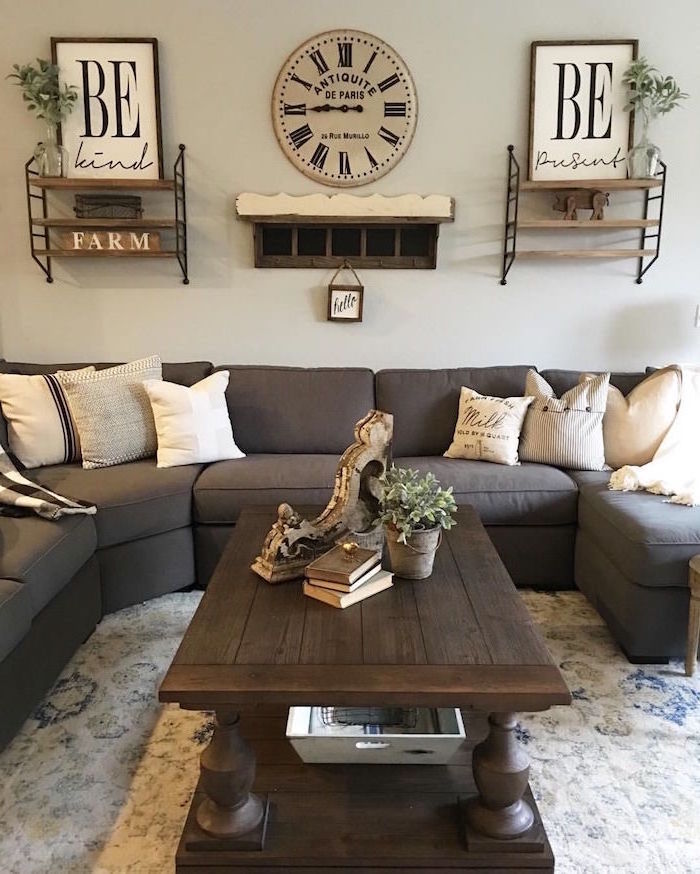 country farmhouse decor, grey corner sofa, wooden coffee table, white carpet and walls