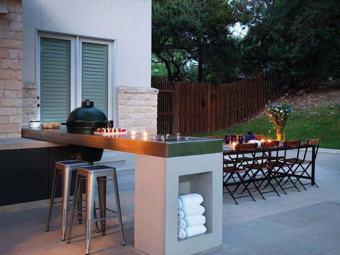 wooden dining table and chairs how to build an outdoor kitchen kitchen island with bar stools stone tiled floor