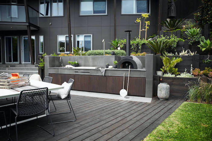 wooden floor and cabinets how to build an outdoor kitchen stone tiled countertops dining table with dark grey metal chairs