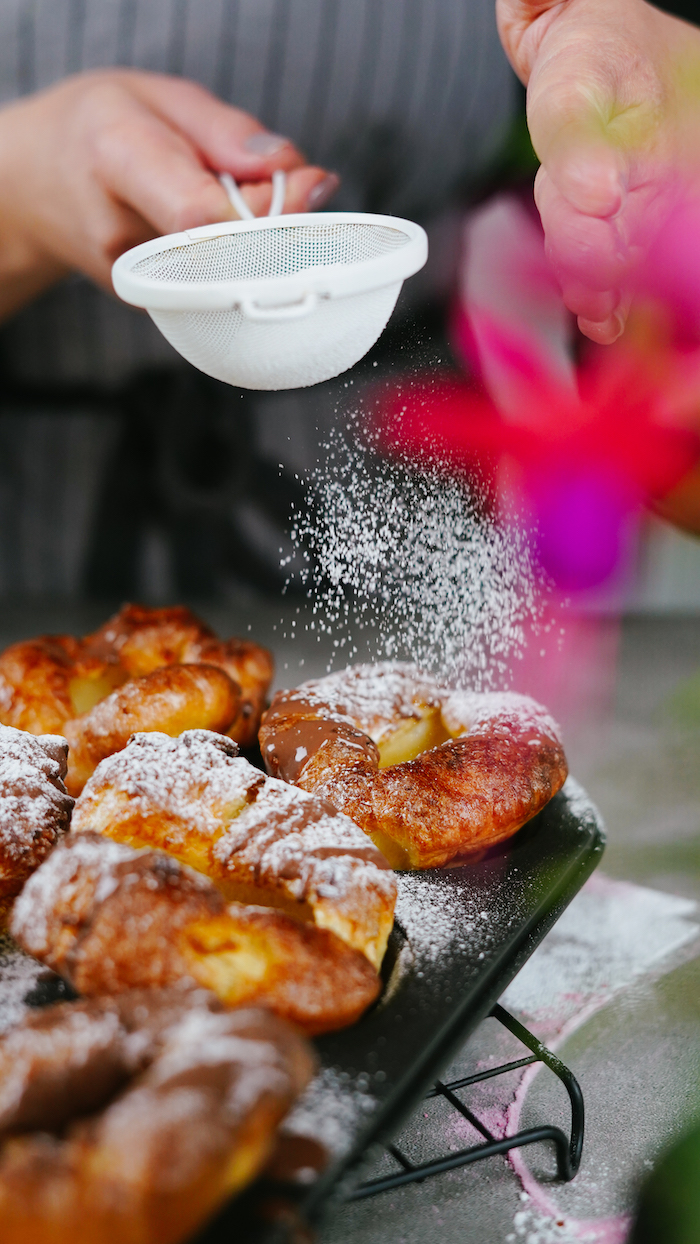 yorkshire puddings baked in muffin baking tray summer desserts for parties covered with powdered sugar