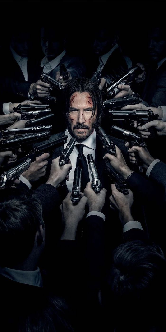 backgrounds for boys keanu reeves as john wick surrounded by men holding guns pointed at him