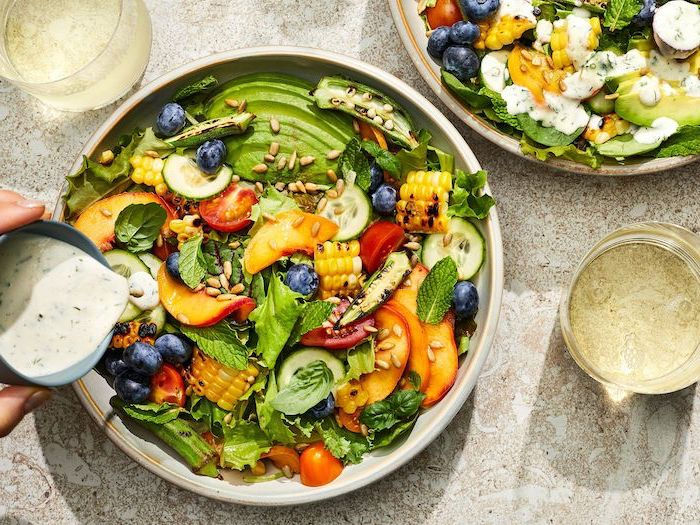 baked corn cherry tomatoes cucumbers avocado peack and blueberries summer salad recipes inside white bowl