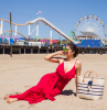 beach with park in the background white summer maxi dress woman on the beach wearing long red dress